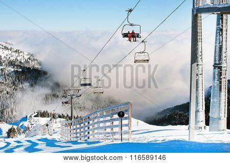 Ski resort Kopaonik, Serbia, ski lift, mountain view, fog