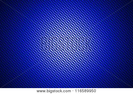 Spotlight On Blue Carbon Fiber Background.