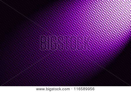 Spotlight On Purple Carbon Fiber Background.