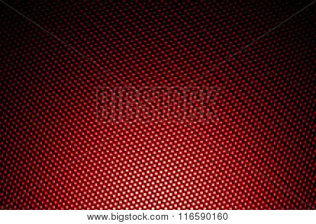 Spotlight On Red Carbon Fiber Background.