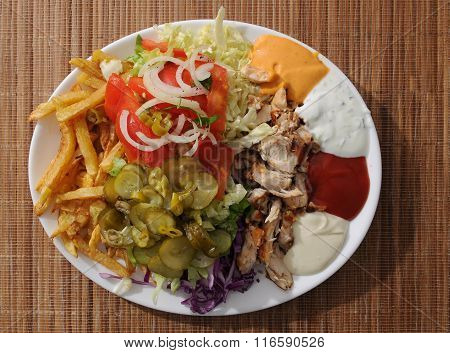 grilled meat with french fries vegetable and dips