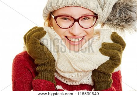 Smiling woman with winter clothing, a cap and a scarf