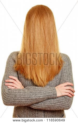Blond young woman with her long hair over her face
