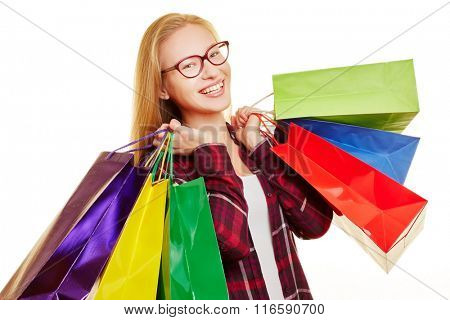 Smiling woman with a lot of colorful shopping bags