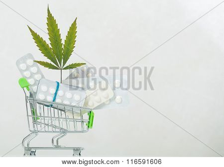 Cannabis leaf background pills