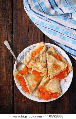 Pancakes with red caviar, top view