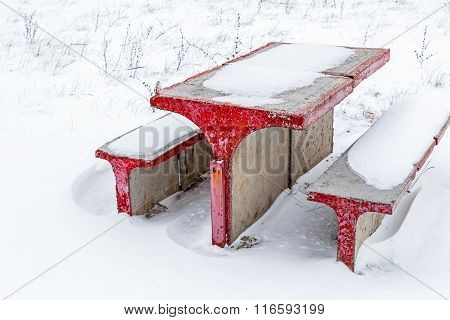 Concrete Table And Chairs In Snow