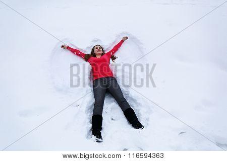 woman lies on snow