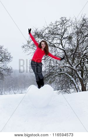 woman standing on the heart of the snow