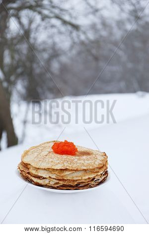 Plate with ruddy pancakes