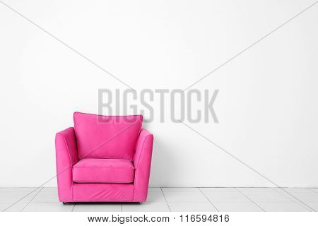 Living room interior with pink armchair on white wall background