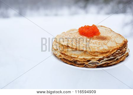 stack of pancakes with caviar