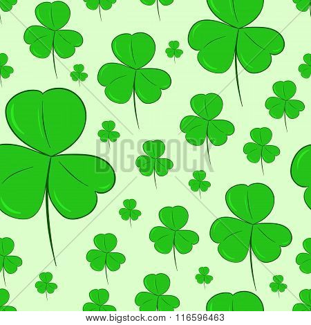 Seamless shamrocks on green
