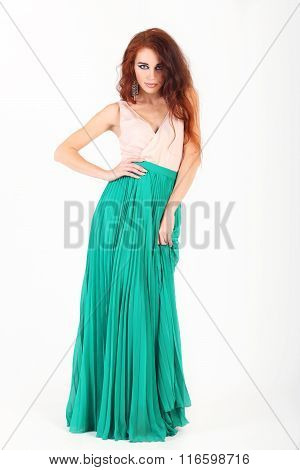Standing Beautiful Young Girl Posing With Make-up Red Hair And Green Skirt