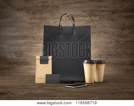 Set of black shopping bag, craft package, two brown coffee cups, blank business cards and generic de