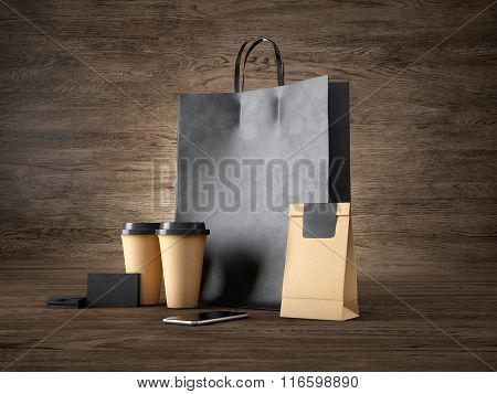 Set of black shopping bag, craft cups, paper package, blank business cards and generic design smartp