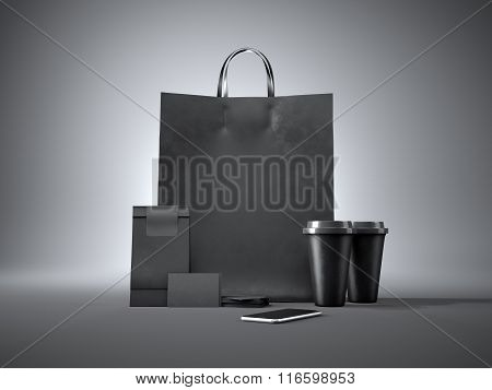 Set of black shopping bag, two coffee cups, paper package, blank business cards and generic design s
