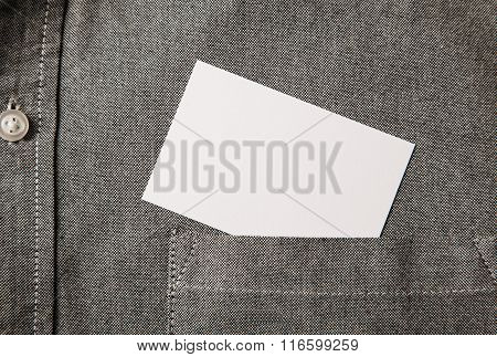 Closeup businesscard on front pocket. Blank white card with copy space in a pocket of shirt.