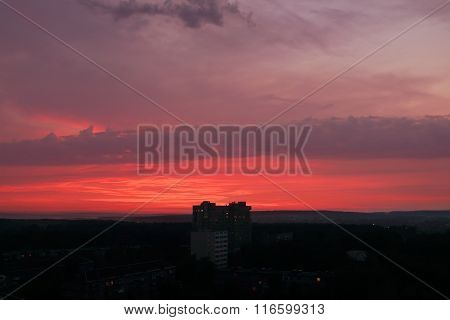 Beautiful Summer Red Sunset And Silhouettes Of Buildings And Skyline