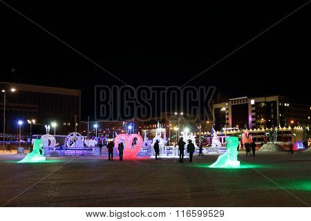 Perm, Russia - Jan 26, 2015: Illuminated Sculptures And People In Ice Town