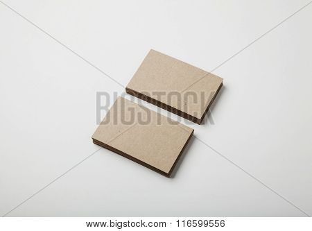 Two stack of blank craft business cards on white background with soft shadows.