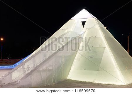 Perm, Russia - Jan 26, 2015: Ice Illuminated Sculpture Egyptian Pyramid With Slide In Ice Town