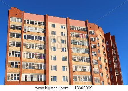 Top Of High Brick Residential Building With Loggies At Sunny Winter Day