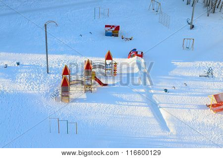 Empty Children Playground Covered By Snow At Sunny Winter Frost Day