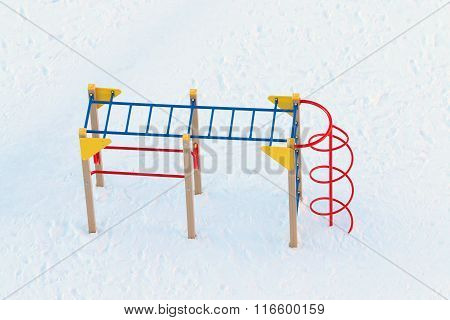 Top View Of Empty Children Playground Covered By Snow At Sunny Winter Frost Day