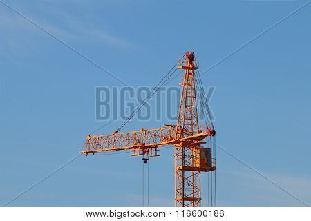 Tall Yellow Stationary Hoist Construction Site And Blue Sky At Sunny Day