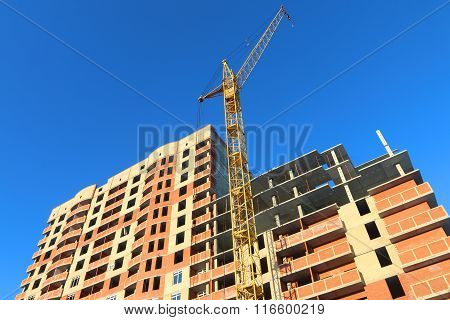 Perm, Russia - Feb 17, 2015: Big Stationary Hoist And Building Under Construction. In 2014 Residenti
