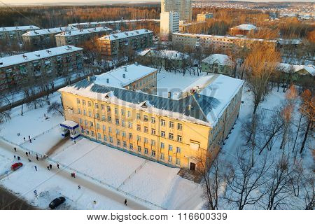 Top View Of Old Yellow Building Of School At Sunny Winter Day In Perm, Russia