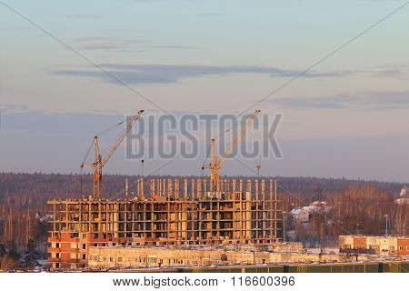 Roofs Of Residential Buildings In Snow And Cranes At Sunny Winter Evening In Perm, Russia