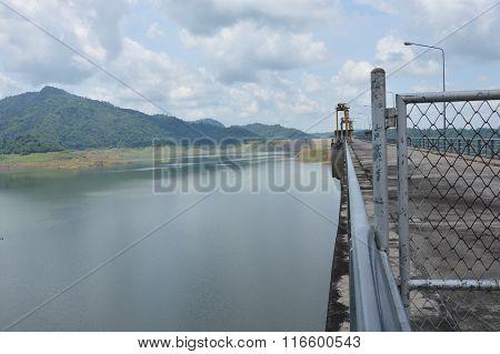 concrete dam on sunshine day