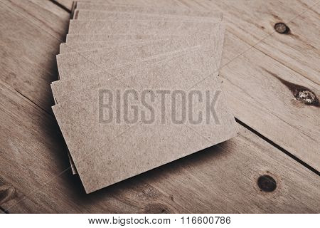 Picture of blank business cards on wood table. Horizontal