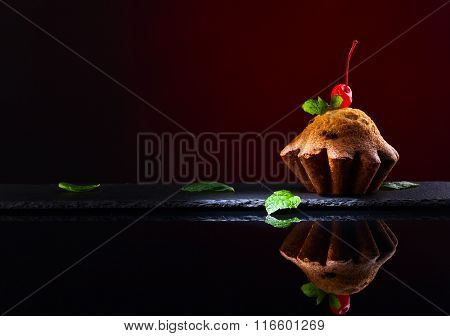 Cupcake On Black Reflective Background