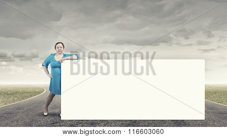 Stout woman with banner