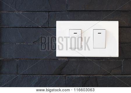 Switch Light On Black Stone Wall