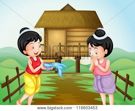 Two thai girls on water festival day illustration