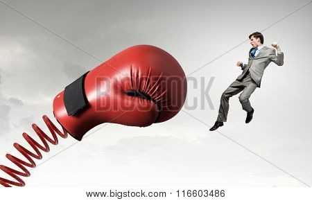 Businessman attacked by glove
