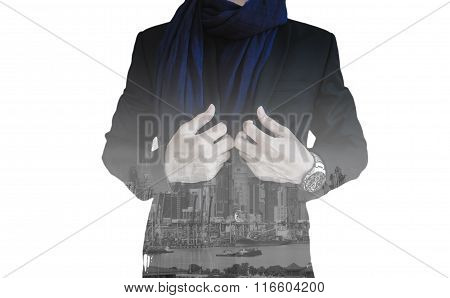 Double exposure of businessman with the city