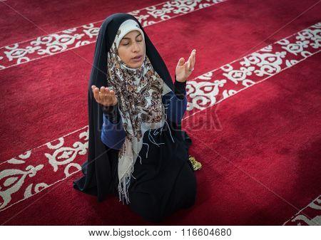 Muslim woman praying inside the mosque