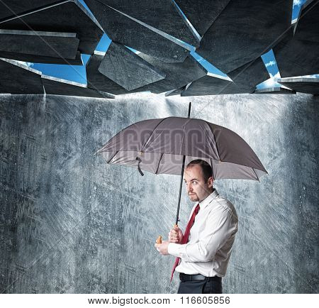 falling roof and businessman with umbrella