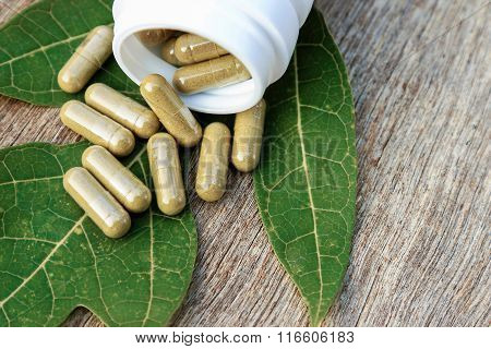 Herbal capsules from box.