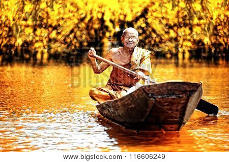 Thailand - JANUARY 22: An unidentified Old monk boating on the lake on 22 Jan 2013 Buddhism in Thai