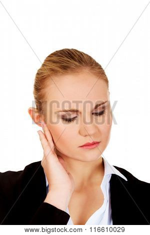 Business woman with huge ear ache