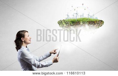 Woman demonstrating alternative energy concept