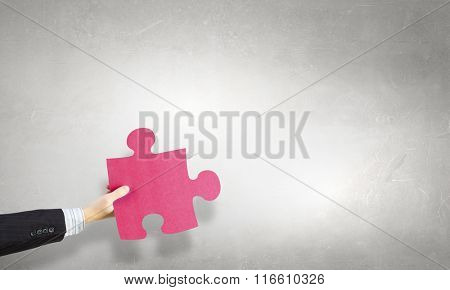 Jigsaw elements in hand