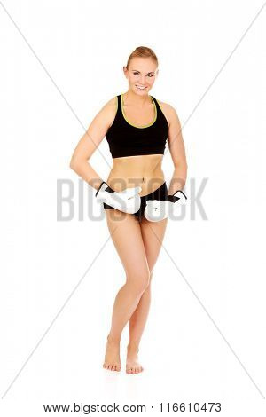 Boxing fitness woman wearing white boxing gloves