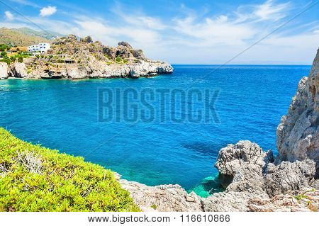 Beautiful Tropical Beach With Clear Turquoise Water And Cliffs.